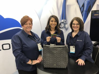 Winner of the BFLOW booth drawing. A coach purse!
