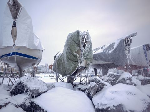 boats-covered-with-tarpaulin-in-tempere-harbor-royalty-free-image-1574287243