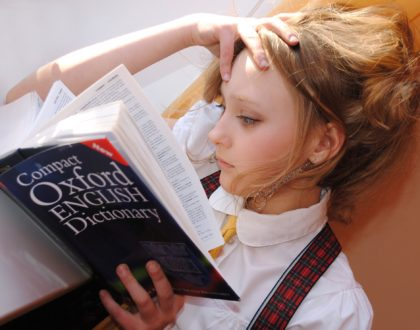 girl learning english from a dictionary