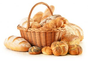 17529848 - composition with bread and rolls in wicker basket isolated on white