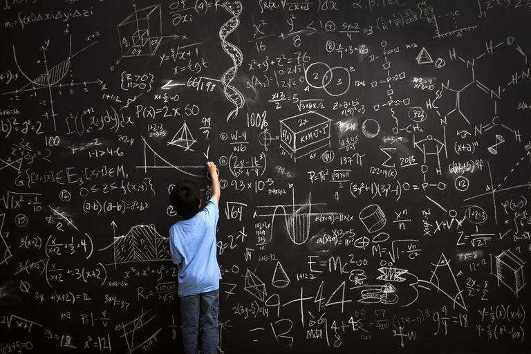 young-boy-writes-math-equations-on-chalkboard-168351254-5ad90020ba61770036501446