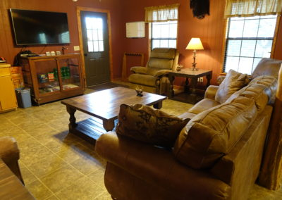 Main living room offers a large flat screen, direct tv and internet access