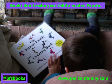 The Pelican Family Series Children's Picture Books when should kids learn to read child holding book