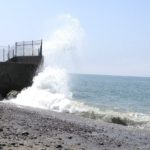 Waves hitting a cement wall