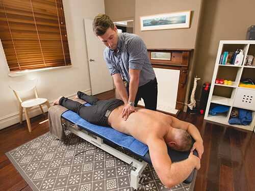 James Weir works on the lower back of a patient