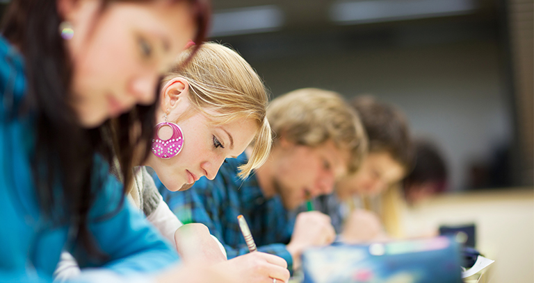 students in classroom taking test