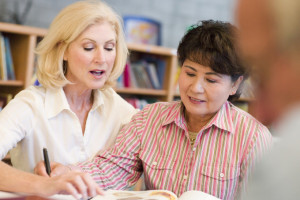 Tutor assisting adult student