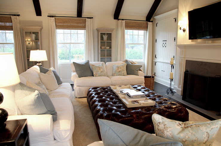 Suzie: via COTE DE TEXAS  Classic family room with stained wood beams, huge leather tufted ...