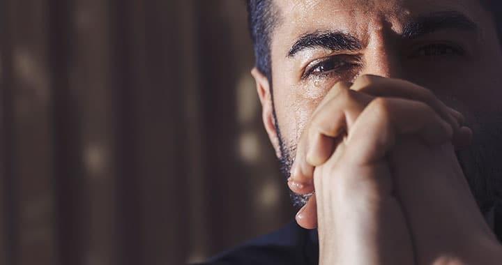 sad hopeful man
