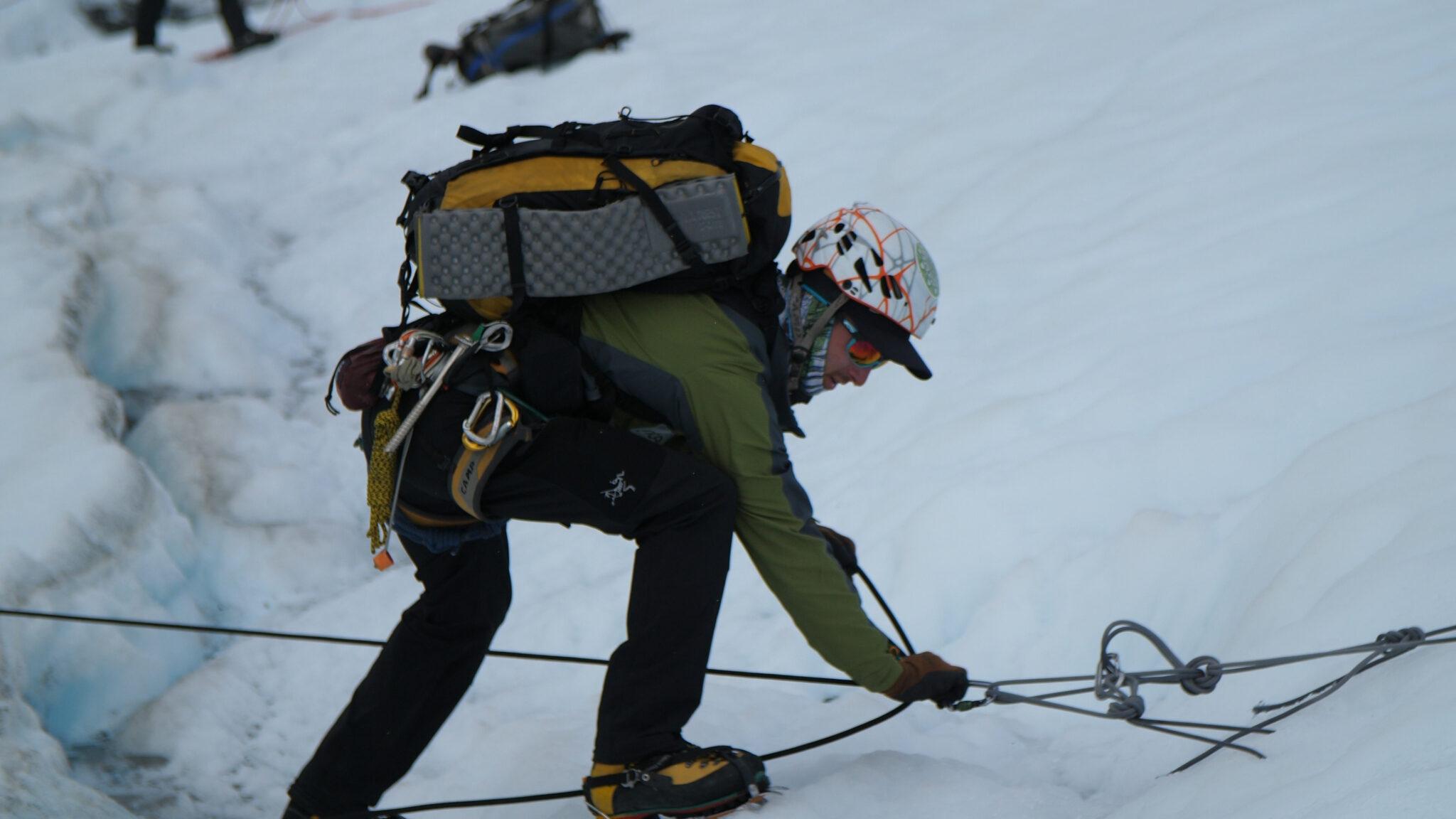 Guide rigging ropes on glacier