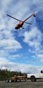 Helicopter flying away with sling load