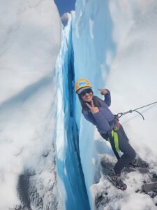 person gives peace sign over crevasse