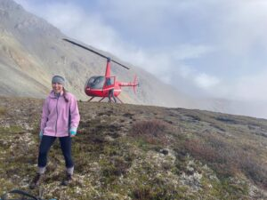 Woman walking away from helicopter