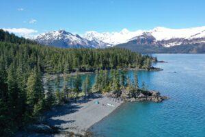 sea kayakers setting up camp Alaska