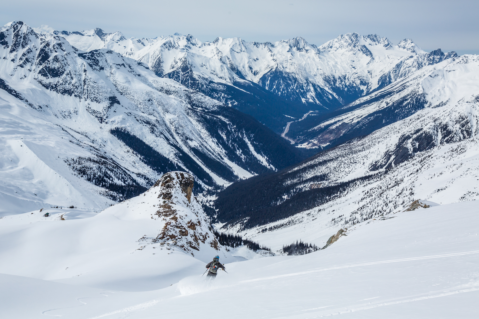 person skiing into mountains snow