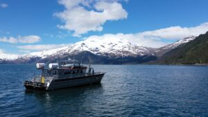 snowy mountains boat