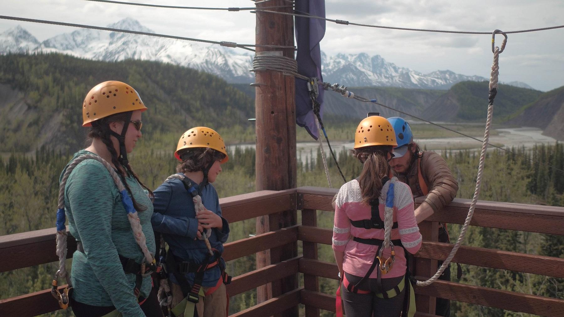 people wearing helmets ropes fencing