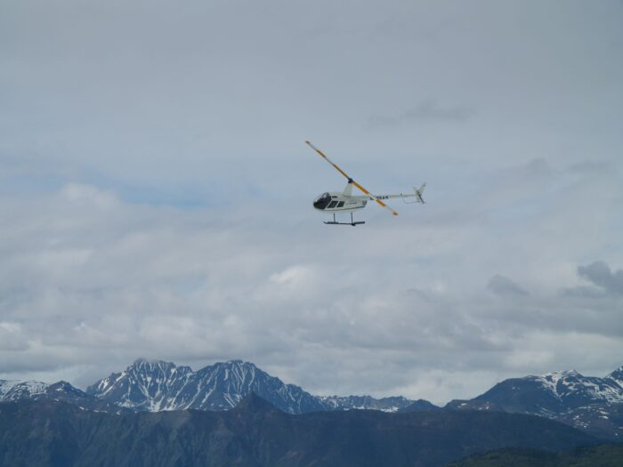 helicopter and mountains