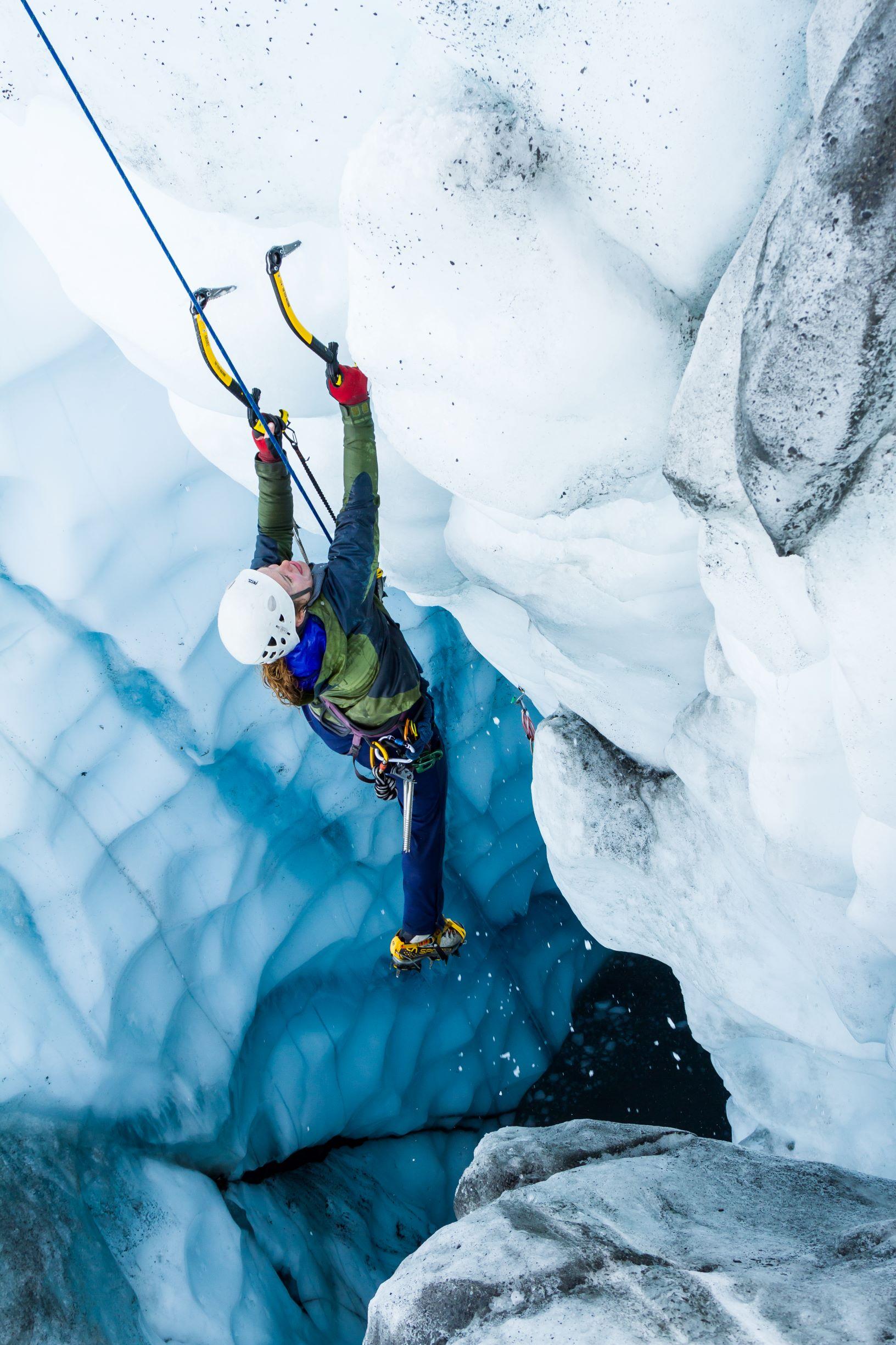 ice climber on blue ice