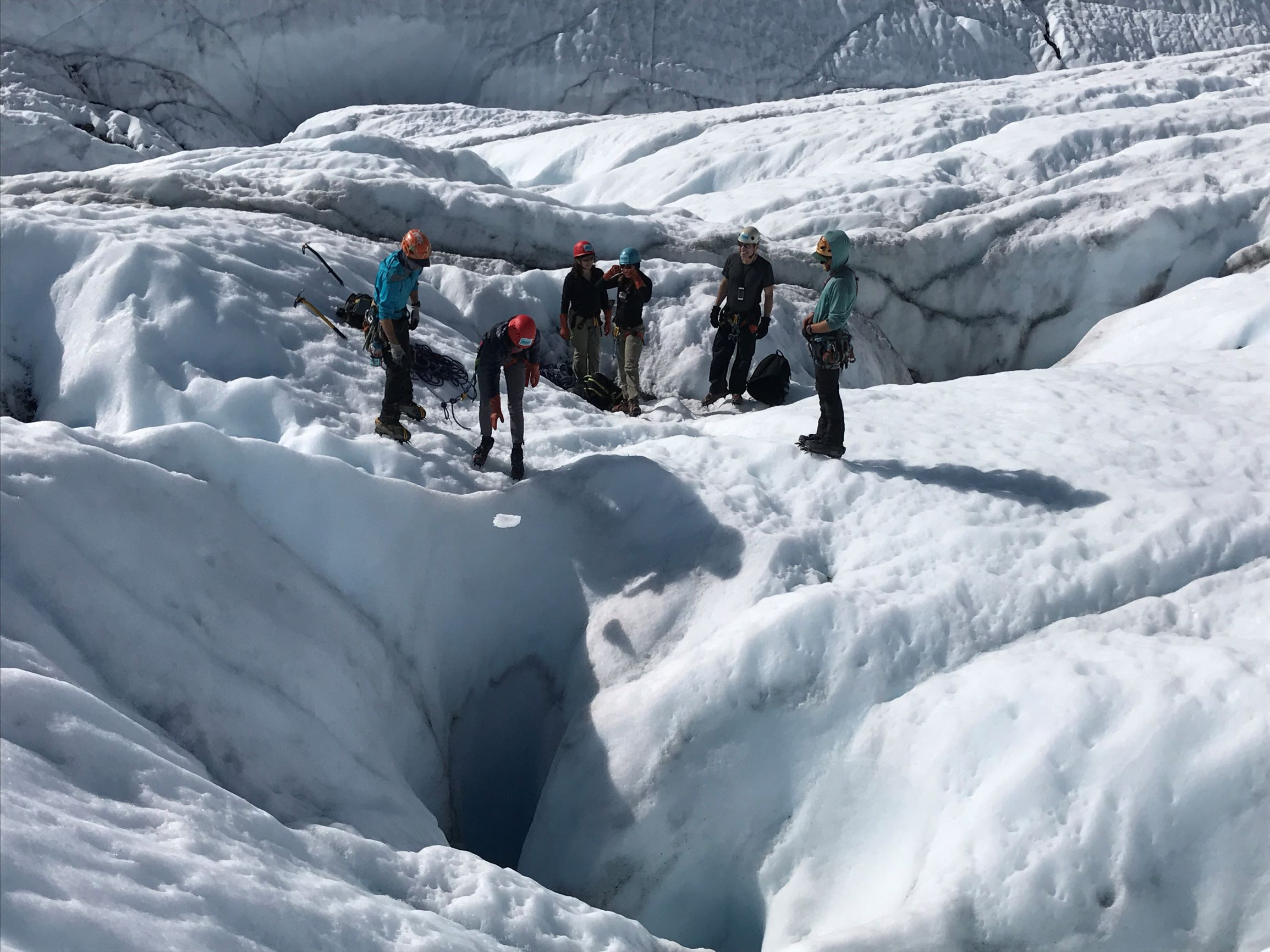 group of people on glacier
