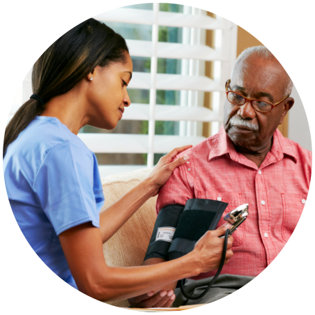 caregiver taking blood pressure of patient