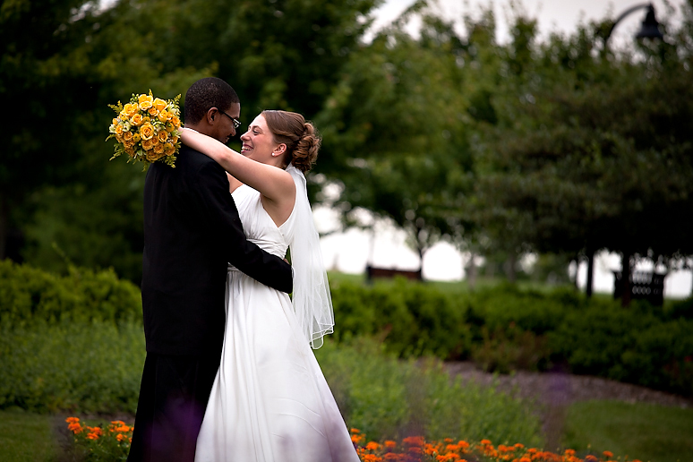 Kristy & Nathaniel wearing a David's Bridal Wedding Gown