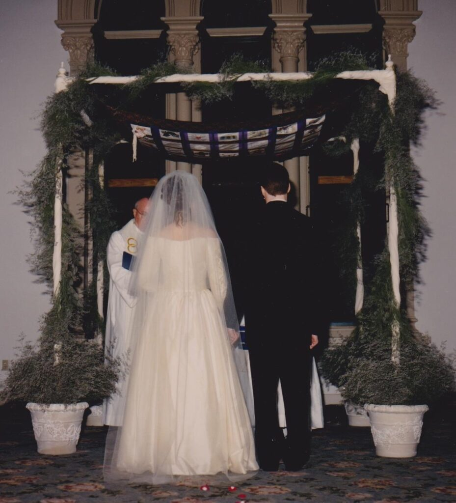 bride and groom under Jewish chuppah.