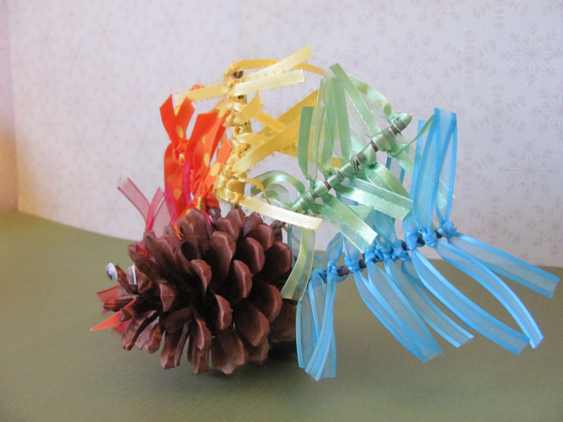 colorful feather on a ribbon feather pinecone turkey