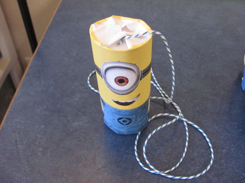 a completed mini minion pinata ready to party