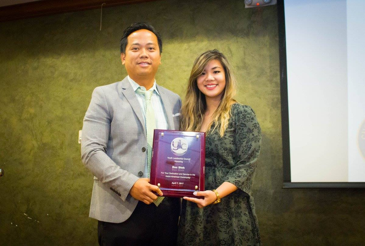April Tieu (President of YLC) and Duc Dinh with the Honoree Award