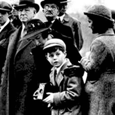 Picture of a young Ted Kennedy holding his first camera, a Brownie Target Six-20.