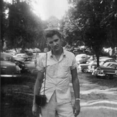 Elvis Presley on the street with a Revere Model 40 8mm Movie Camera.