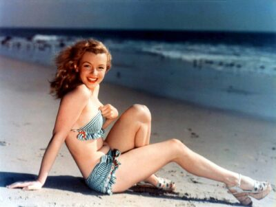 Norma Jeane Baker (later known as Marilyn Monroe)- posing on the beach. Photo by David Conover.