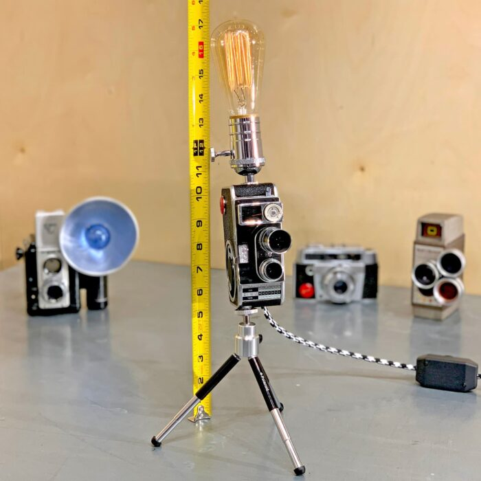 Showing measurements using measuring tape of Rosie's Workshop original vintage camera accent light - Steven Spielberg's First Movie Camera – Bolex B8SL. All parts are UL component listed (c UR us) for United States and Canada.