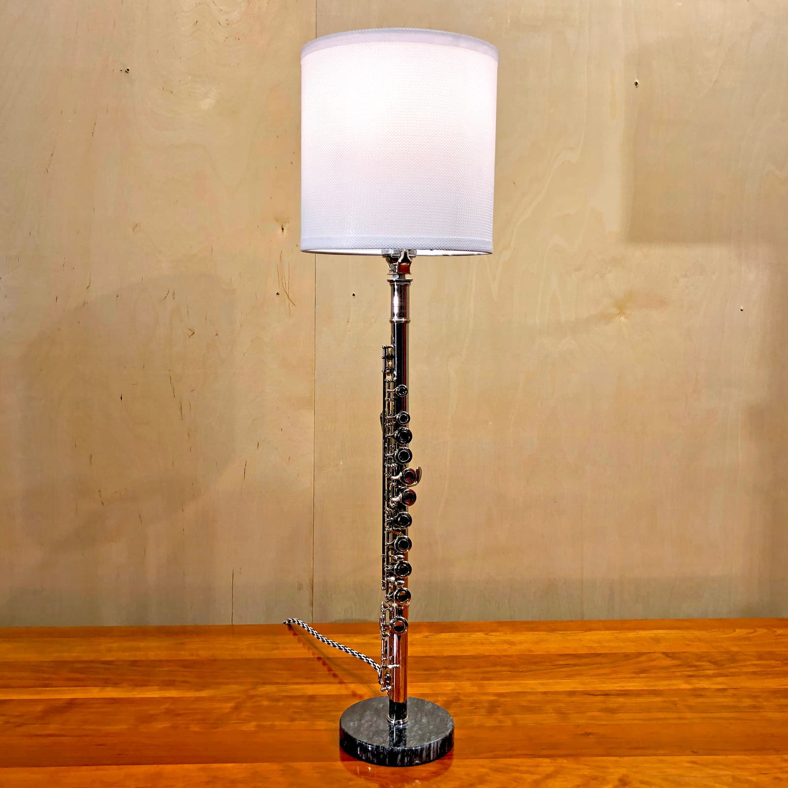 Another view of Rosie's Workshop original flute table light with white lamp shade. All parts are UL component listed (c UR us) for United States and Canada.