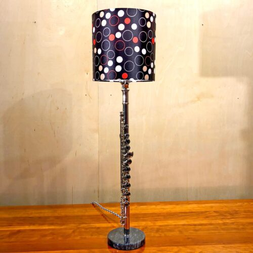 Front view of Rosie's Workshop original flute table light with red and black lamp shade. All parts are UL component listed (c UR us) for United States and Canada.