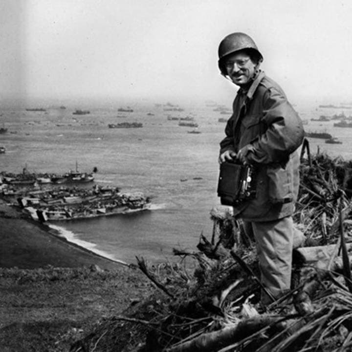 Photographer Joe Rosenthal stands on Mt. Suribachi after the flag raising on February 23- 1945