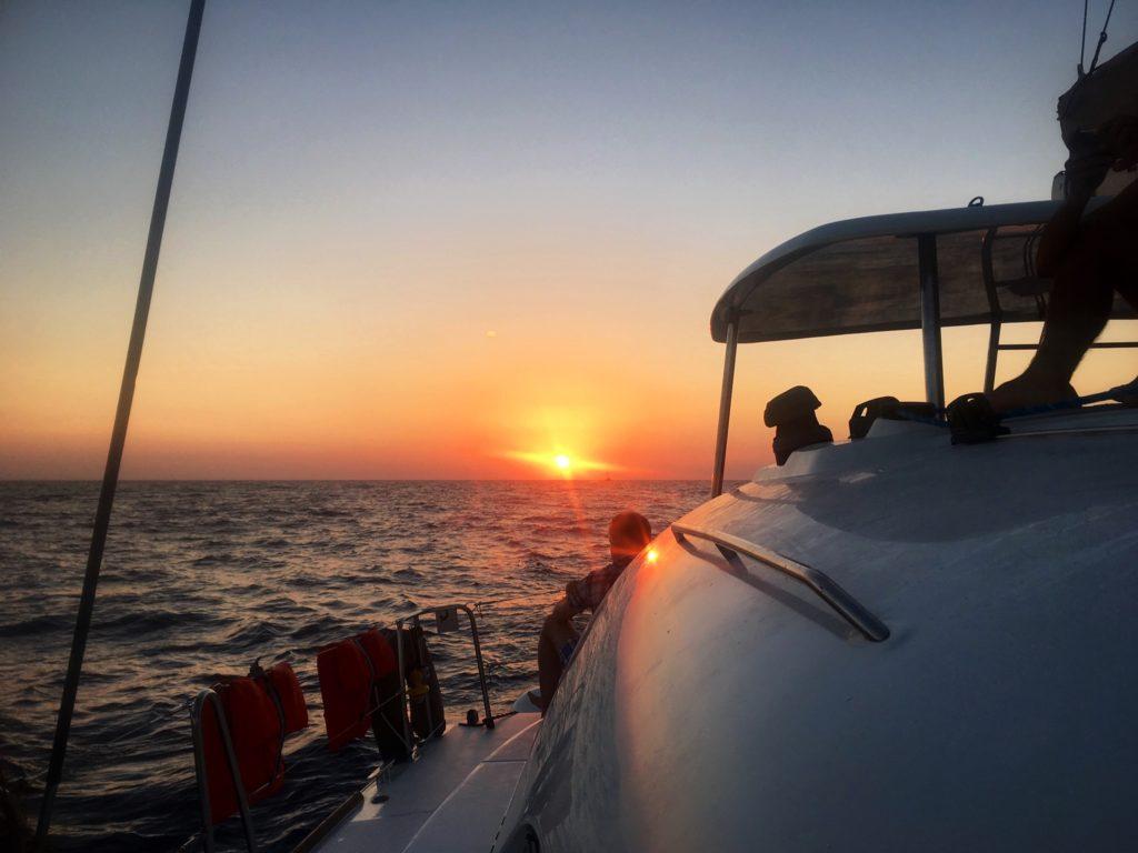 santorini sunset; sunset cruise; catamaran cruise; catamaran sunset; santorini sunset cruise; greek sunset; sunset over the water