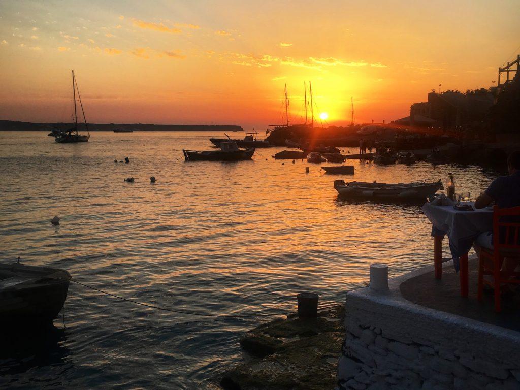 santorini sunset; ammoudi bay; ammoundi bay sunset; oia sunset; greek sunset; sunset over the water