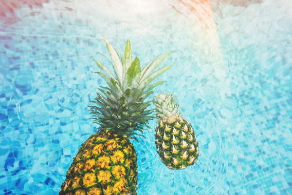 Summer swimming pool with pineapples