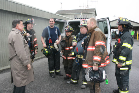CAPTION FOR PHOTO: Brookhaven Town Supervisor Ed Romaine with some of the firefighters at the scene that day. Romaine pledged a streamlined planning and permit process so rebuilding may commence in Cherry Grove as soon as possible. (Photo courtesy Town of Brookhaven.)