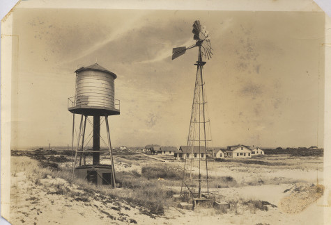 2.The original Kismet water tower with houses in the background, year unknown.