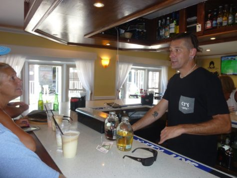 Rob Webber serving up Pappa's Pilar rum in CJ's