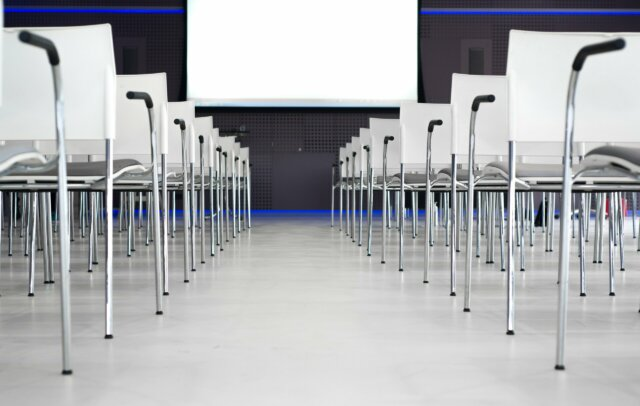 Stock image of chairs and display in conference room to signify Kinney Group Event's av rental and even production services in NYC.