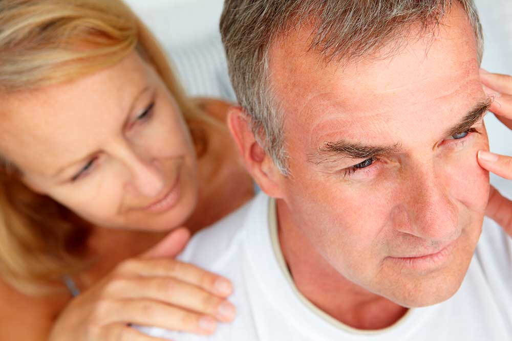 anxious man comforted by wife