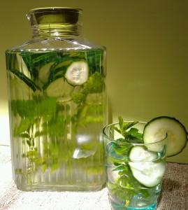 Cucumber water with sprigs of lemon balm and peppermint.