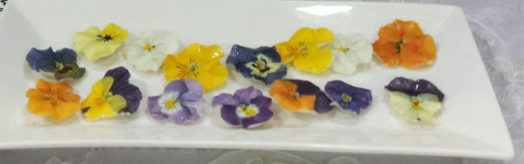 These assorted edible pansies are sold by Fresh Origins, too, and available to chefs and bakers.