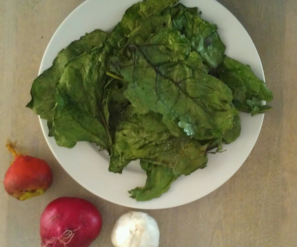 Garlic roasted beet leaf chips with sea salt make a healthy and tasty snack that are  worth making, especially if you love kale chips. Plus, they're a great substitute for potato chips!