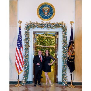 Nicole with her dad at the White House Holiday Party in 2016