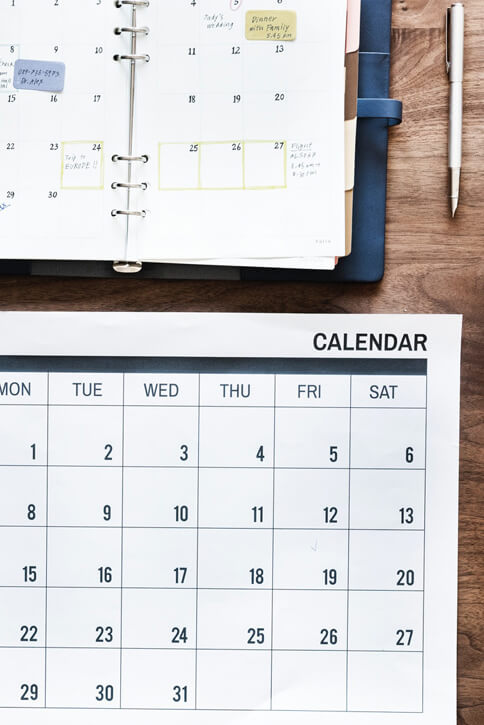Image of a calendar and a planner